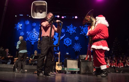 Santa playing the tuba with Washboard Hank on the kitchen sink.